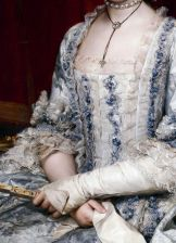 Compere front, blue trim on white dress. Detail from Infanta Maria Luisa de Borbon, gran duquesa de Toscana by Anton Rafael Mengs, circa 1770.