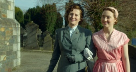 """Jane Brennan as """"Mary"""" and Saoirse Ronan as """"Eilis"""" in BROOKLYN. Photo courtesy of Fox Searchlight Pictures. © 2015 Twentieth Century Fox Film Corporation All Rights Reserved"""
